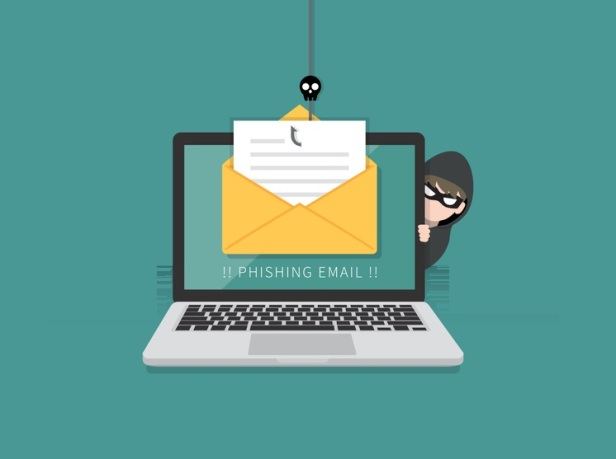 Email data phishing with cyber thief hide behind Laptop computer. Hacking concept.