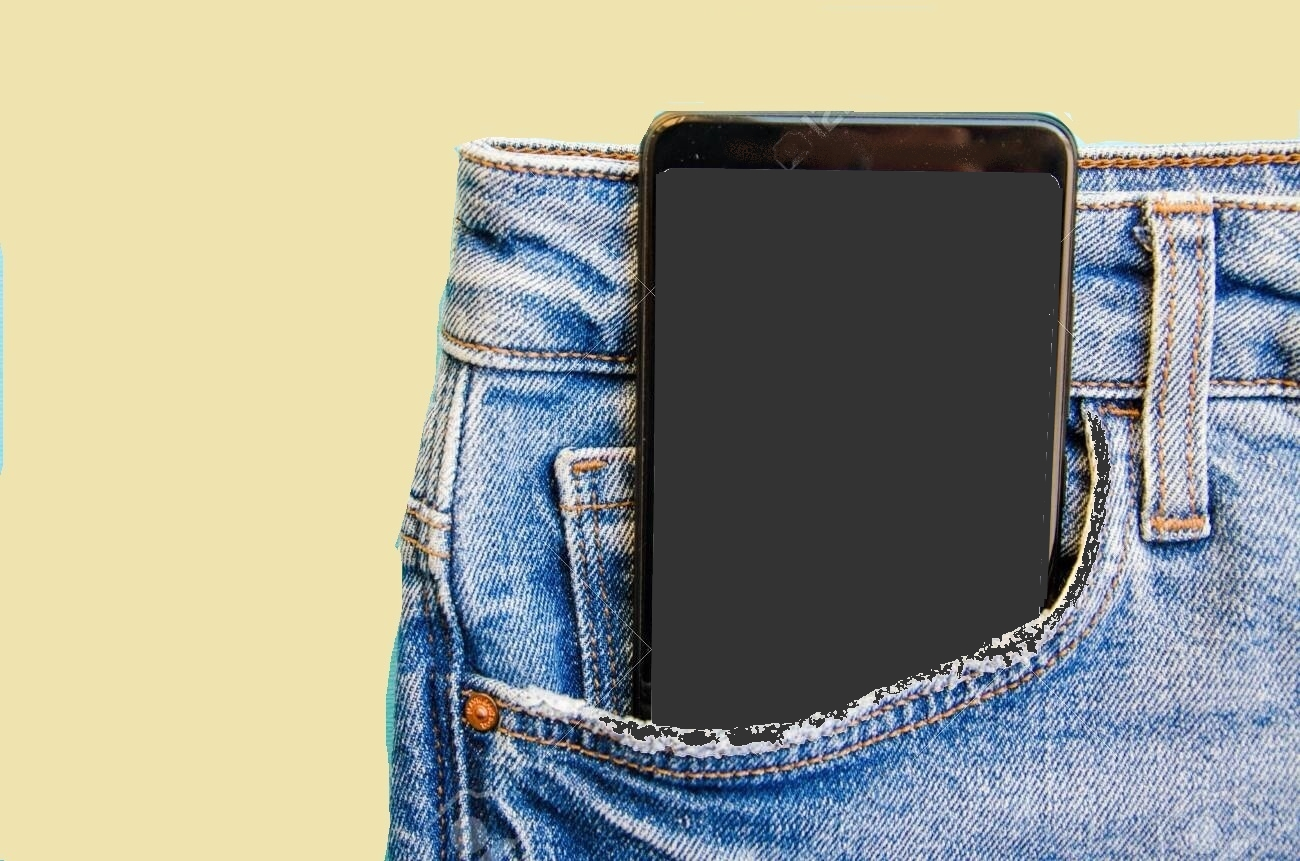 White screen smartphone in jeans pocket. Smartphone place for text. Smartphone in a pocket on a blue background.  Copy Space