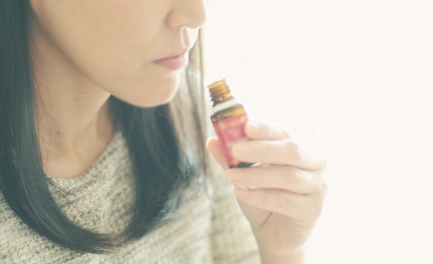 Woman smelling the essential oil